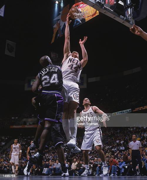 Forward Keith Van Horn of the New Jersey Nets shoots over guard Bobby Jackson of the Sacramento Kings during the NBA game at Continental Airlines...