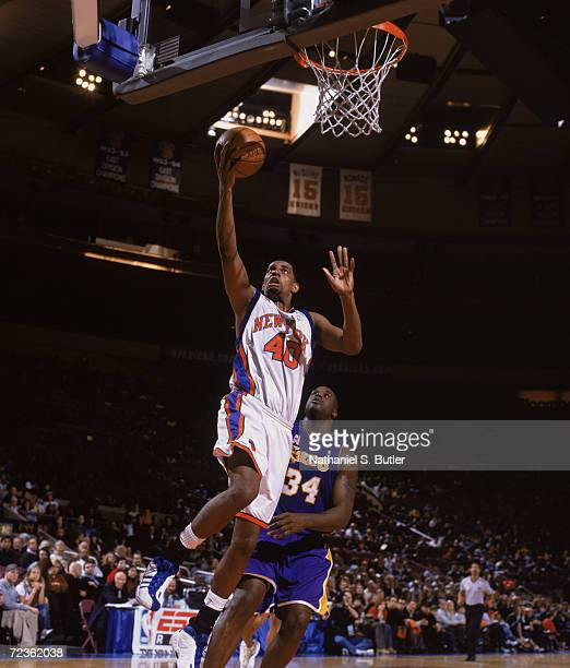 Forward Kurt Thomas of the New York Knicks shoots the ball as center Shaquille O''Neal of the Los Angeles Lakers stands under the basket during the...