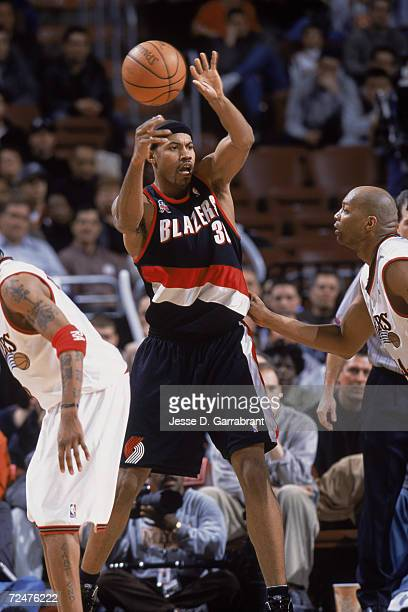 Forward Rasheed Wallace of the Portland Trail Blazers passes the ball as center Derrick Coleman of the Philadelphia 76ers plays defense during the...