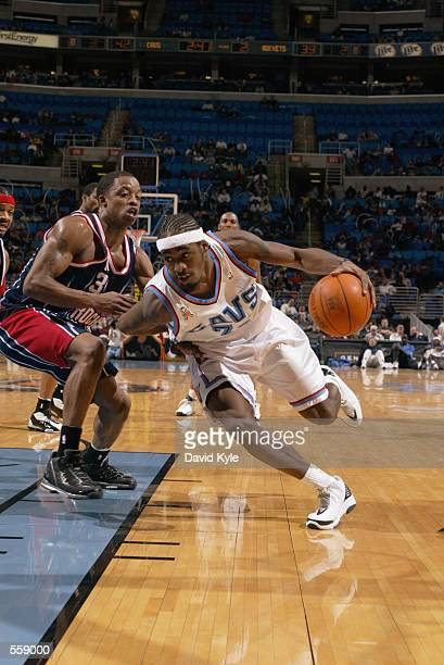 Forward Ricky Davis of the Cleveland Cavaliers dribbles the ball around guard Steve Francis of the Houston Rockets during the NBA game at Gund Arena...