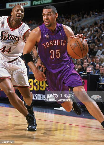 Forward Tracy Murray of the Toronto Raptors dribbles the ball around forward Derrick Coleman of the Philadelphia 76ers during the NBA game at the...