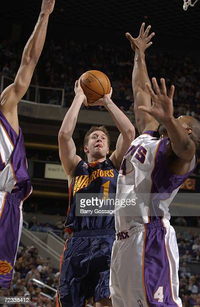 Forward Troy Murphy of the Golden State Warriors shoots over forward Alton Ford of the Phoenix Suns during the NBA game at America West Arena in...