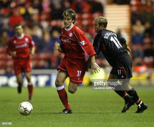 Franck Queudrue of Middlesbrough takes the ball past John Robinson of Charlton Athletic during the FA Barclaycard Premiership match played at the...