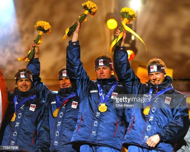 Frode Andersen Ole Einar Bjoerndalen Egil Gjelland and Halvard Hanevold of Norway receive their gold medals in the men's 4x75km biathlon relay at the...