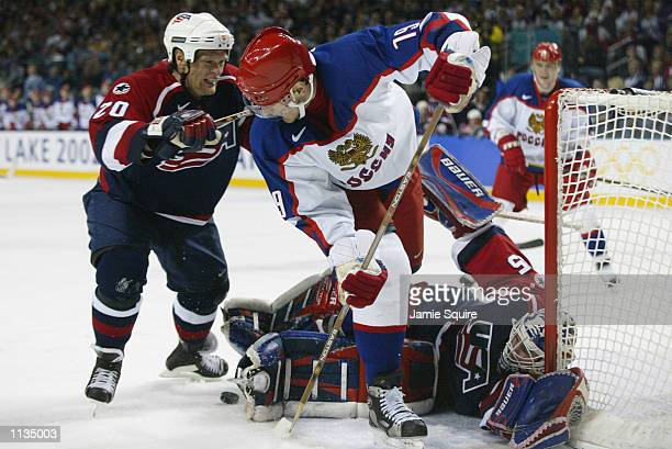 Gary Suter and goalie Mike Richter of the USA block a shot by Alexei Yashin of Russia in the men's ice hockey semifinal during the Salt Lake City...