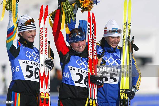Gold medal winner Andrea Henkel of Germany silver medal winner Liv Grete Poiree of Norway and bronze medal winner Magdalena Forsberg of Sweden...