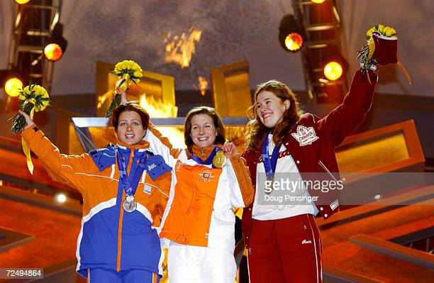 Gretha Smit silver Claudia Pechstein gold and Clara Hughes bronze celebrate with their medals from the Ladies 5000m Speed Skating during the Medals...
