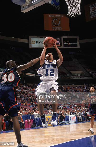 Guard Andre Barrett of the Seton Hall Pirates shoots the ball as guard Frank Williams of the Illinois Fighting Fighting attempts to block during the...