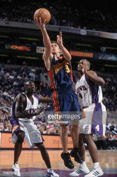 Guard Bob Sura of the Golden State Warriors shoots the ball as forward Alton Ford of the Phoenix Suns plays defense during the NBA game at the...