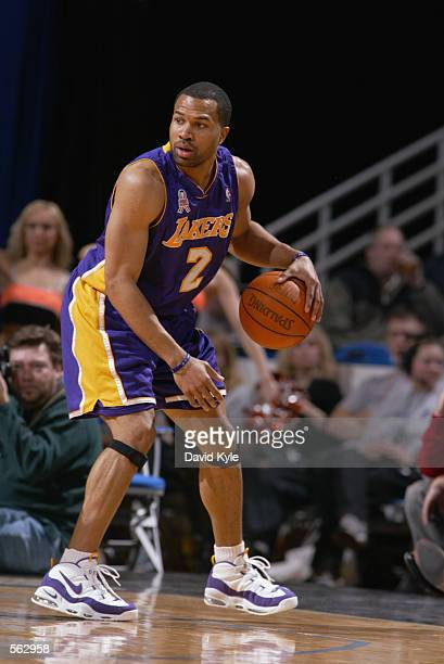 Guard Derek Fisher of the Los Angeles Lakers dribbles the ball during the NBA game against the Cleveland Cavaliers at Gund Arena in Cleveland Ohio...