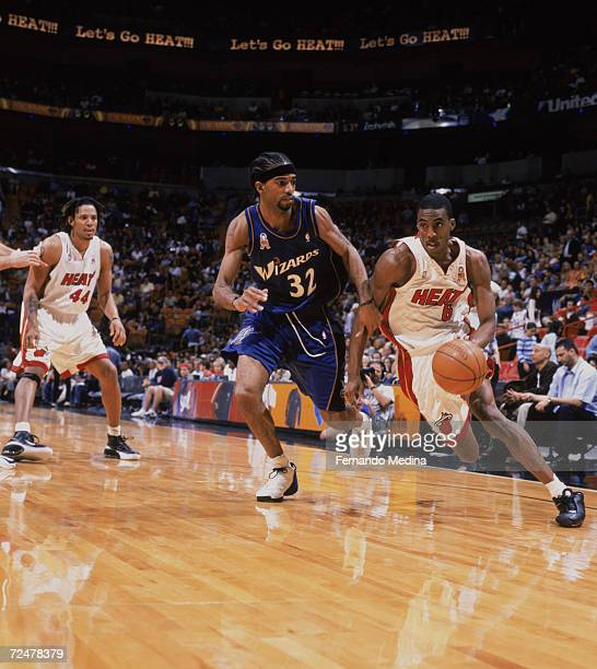 Guard Eddie Jones of the Miami Heat dribbles the ball around guard Richard Hamilton of the Washington Wizards during the NBA game at the American...
