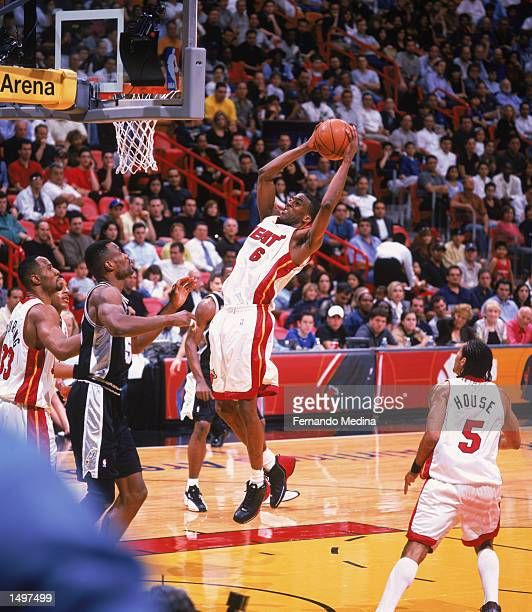 Guard Eddie Jones of the Miami Heat grabs a rebound during the NBA game against the San Antonio Spurs at American Airlines Arena in Miami Florida The...
