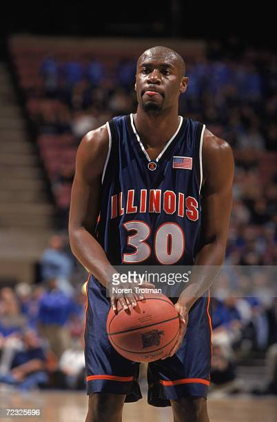 Guard Frank Williams of the Illinois Fighting Fighting Illini attempts a free throw during the NCAA game against the Seton Hall Pirates at the...