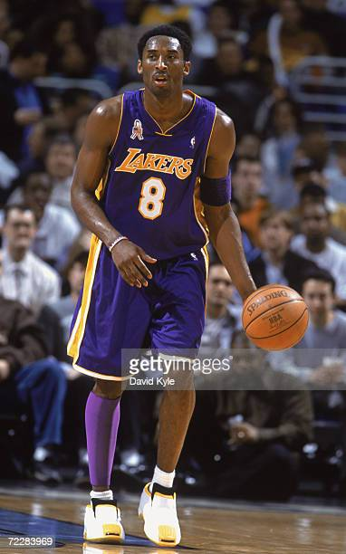 Guard Kobe Bryant of the Los Angeles Lakers dribbles the ball during the NBA game against the Cleveland Cavaliers at the Gund Arena in Cleveland Ohio...