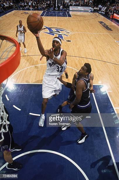 Guard Richard Hamilton of the Washington Wizards shoots the ball as forward Chris Webber of the Sacramento Kings plays defense during the NBA game at...