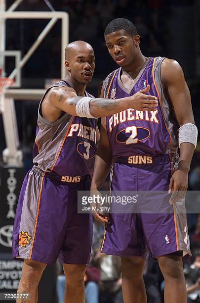 Guard Stephon Marbury of the Phoenix Suns talks to his teammate forward Joe Johnson during the NBA game against the Memphis Grizzlies at the Pyramid...