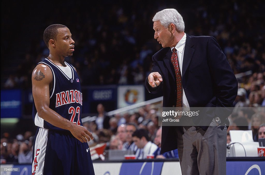 Head coach Lute Olson of Arizona Wildcats talks to his guard Jason Gardner #22 during the Pac-10 game against the UCLA Bruins at the Pauley Pavilion in Westwood, California. The Bruins defeated the Wildcats 77-76. \ Mandatory Credit: Jeff Gross/Getty Images