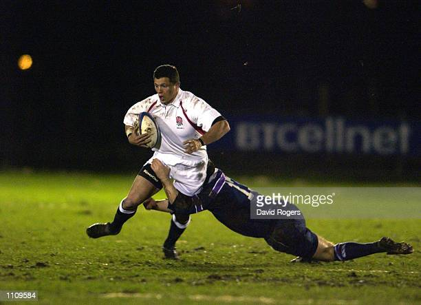 Henry Paul of England ''A'' is tackled by Kevin Utterson of Scotland ''A'' during the ''A'' International Friendly match played at Bridgehaugh in...
