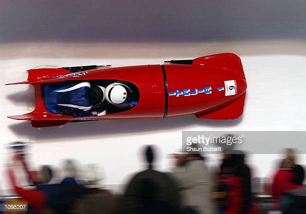 Italy 1 with Gerda Weissensteiner and Antonella Bellutti compete in the 2woman bobsled during the Salt Lake City Winter Olympic Games at the Utah...