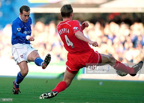 Jamie Clapham of Ipswich has his shot at goal stopped by Sami Hyypia of Liverpool during the FA Barclaycard Premiership match between Ipswich Town...