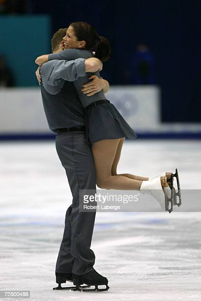 Jamie Sale and David Pelletier of Canada celebrate after their routine in the Pairs Free Program Figure Skating at the Salt Lake Ice Center during...