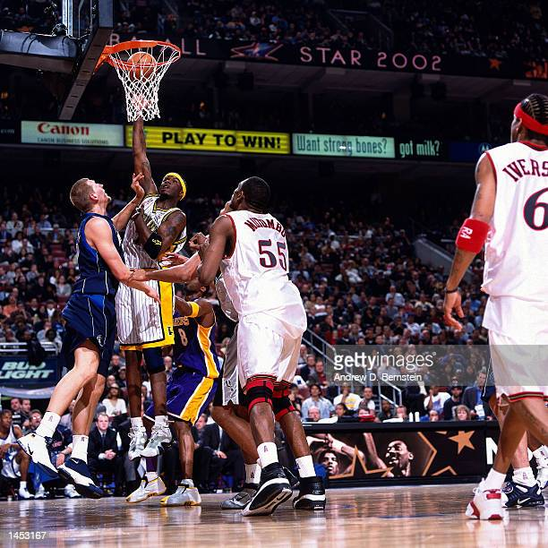 Jermaine O''Neal of the Indiana Pacers shoots over Dirk Nowitzki of the Dallas Mavericks during the 2002 NBA All Star Game at the First Union Center...