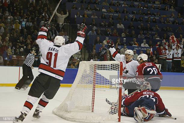 Joe Sakic of Canada celebrates an assist to Jarome Iginla who scored a goal on Mike Richter of the USA during the first period of the mens ice hockey...
