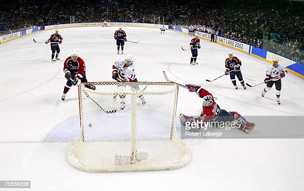 Joe Sakic of Canada watches the puck go in for a goal past goalkeeper Mike Richter of the USA on a shot by Jarome Iginla of Canada during the men's...