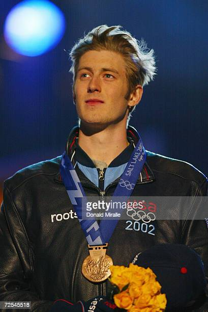 Joey Cheek of the USA stands on the podium with his bronze medal in the men's 100 meter long track at the medal awards ceremony at the Olympic Medals...