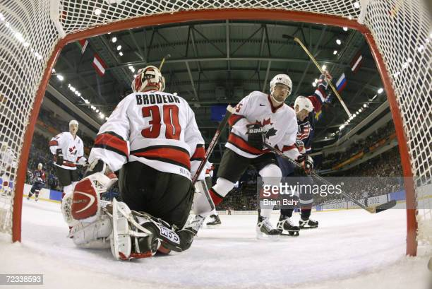 John LeClair of the USA celebrates Brian Rafalski's goal that got past goaltender Martin Brodeur of Canada and defenseman Ed Jovanovski during the...