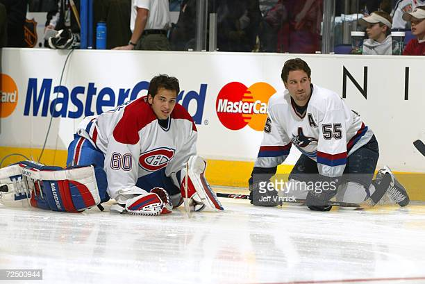 Jose Theodore of the Montreal Canadiens and Ed Jovanovski of the Vancouver Canucks during the NHL Allstar Skills competition at the Staples Center in...