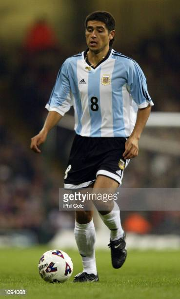 Juan Roman Riquelme of Argentina runs with the ball during the International Friendly match against Wales played at the Millennium Stadium in Cardiff...