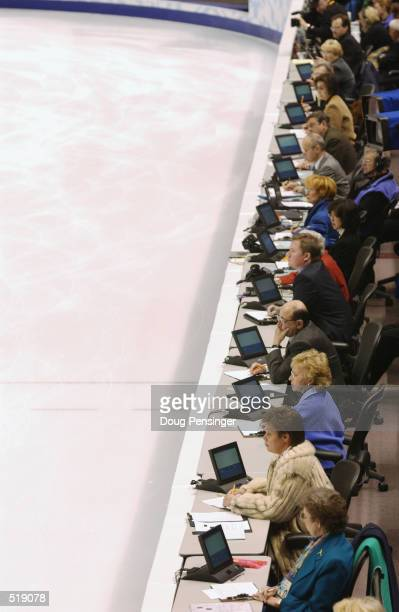 Judges watch the competitors during the men's free program during the Salt Lake City Winter Olympic Games at the Salt Lake Ice Center in Salt Lake...