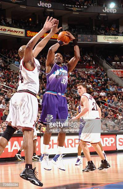 Karl Malone of the Utah Jazz shoots over Derrick Coleman of the Philadelphia 76ers during their game at First Union Center in Philadelphia,...