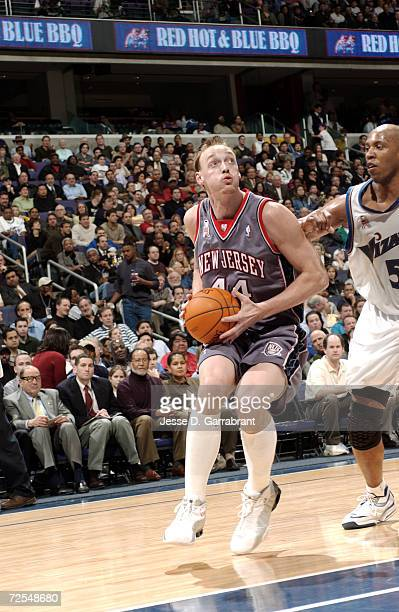 Keith Van Horn of the New Jersey Nets goes to the basket against Popeye  Jones of 97d072f68