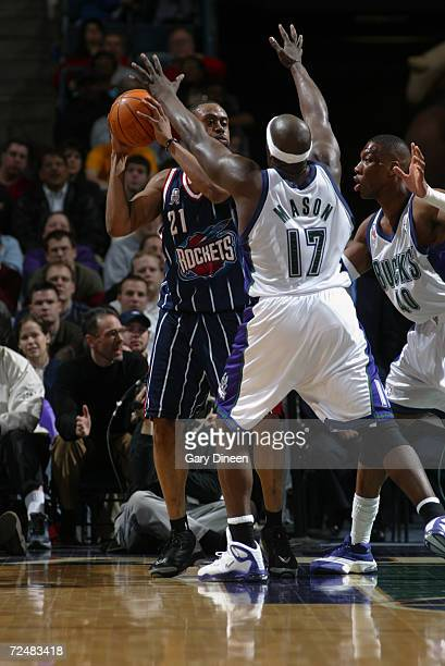 Kenny Thomas of the Houston Rockets looks to pass around Anthony Mason and Ervin Johnson, both of the Milwaukee Bucks during their game at Bradley...