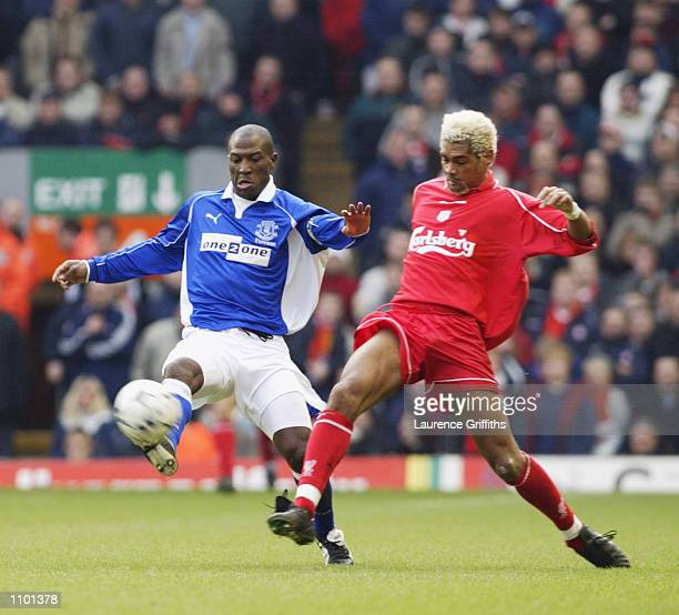 Kevin Campbell of Everton challenges Abel Xavier of Liverpool during the FA Barclaycard Premiership match played at Anfield in Liverpool England The...