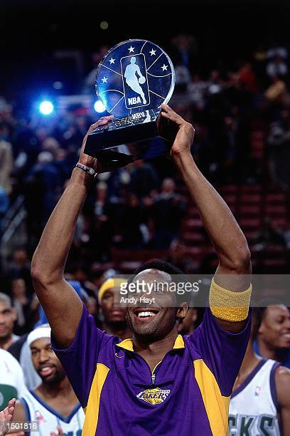 Kobe Bryant displays his MVP Award after the 2002 NBA All Star Game at the First Union Center in Philadelphia, Pennsylvania. NOTE TO USER: User...