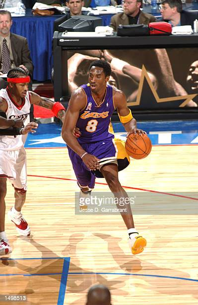Kobe Bryant of the Los Angeles Lakers drives by Allen Iverson of the Philadelphia 76ers the 2002 AllStar game at the First Union Center Philadelphia...
