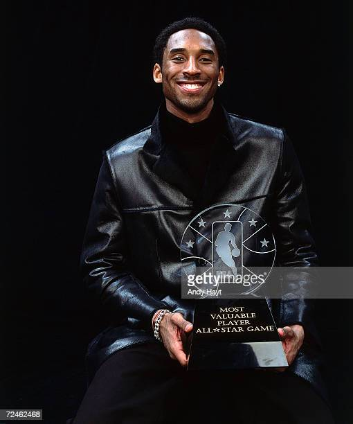 Kobe Bryant of the Los Angeles Lakers poses for a portrait with AllStar MVP Trophy during the 2002 NBA AllStar Week at the First Union Center in...
