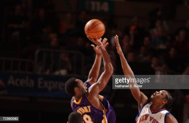 Kobe Bryant of the Los Angeles Lakers shoots over Latrell Sprewell of the New York Knicks at Madison Square Garden in New York, New York. DIGITAL...