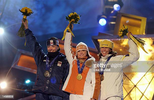 Liv Grete Poiree of Norway silver Andrea Henkel of Germany gold Magdalena Forsberg of Sweden bronze receive their medals in the women's 15km...