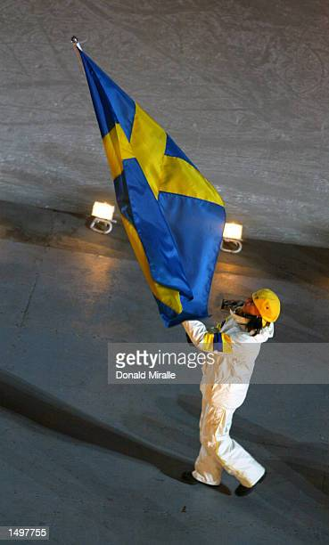 Magdalena Forsberg of Sweden carries the Swedish flag as the team enters the stadium during the Opening Ceremony of the Salt Lake City Winter Olympic...