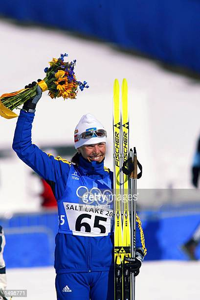 Magdalena Forsberg of Sweden celebrates winning the bronze medal in the women's 15km biathlon during the Salt Lake City Winter Olympic Games at...