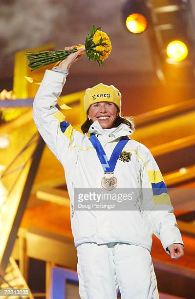 Magdalena Forsberg of Sweden receives her bronze medal in the women's biathlon 75km sprint at the medal awards ceremony at the Olympic Medals Plaza...