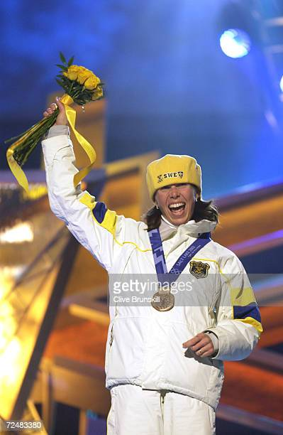Magdalena Forsberg of Sweden receives her bronze medal in the women's 15km individual biathlon at the medal awards ceremony at the Olympic Medals...