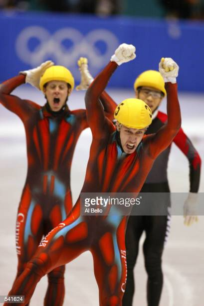 Marc Gagnon of Canada celebrates his win in the men's 500m in front of teammate Jonathan Guilmette who took second during the Salt Lake City Winter...