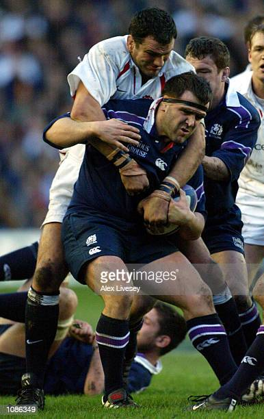 Martin Johnson of England stops Tom Smith of Scotland during the Six Nations Championship match between Scotland and England at Murrayfield Edinburgh...