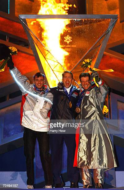 Martin Rettl of Austria, silver, Jim Shea of the USA, gold, Gregor Staehli of Switzerland, bronze, receive their medals in the men's skeleton at the...