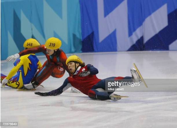 Mathieu Turcott of Canada crashes into Apolo Anton Ohno of the USA and HyunSoo Ahn of Korea as they compete in the men's 1000m speed skating final...